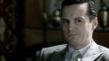 S2E3_moriarty-making-a-skeptical-facein-grey-suit